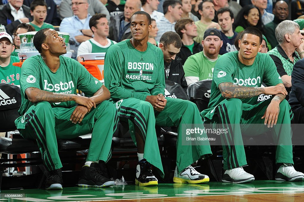 Rajon Rondo #9 of the Boston Celtics looks on from the bench during the game against the Washington Wizards on April 16, 2014 at the TD Garden in Boston, Massachusetts.