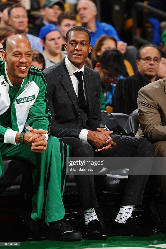 Rajon Rondo #9 of the Boston Celtics looks on from the bench during the game against the Memphis Grizzlies on November 27, 2013 at the TD Garden in Boston, Massachusetts.