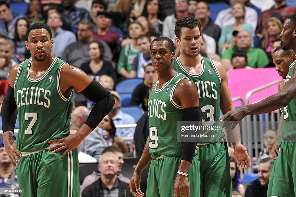 <a gi-track='captionPersonalityLinkClicked' href=/galleries/search?phrase=Rajon+Rondo&family=editorial&specificpeople=206983 ng-click='$event.stopPropagation()'>Rajon Rondo</a> #9 of the Boston Celtics looks on with his teammates against the Orlando Magic during the game on January 19, 2014 at Amway Center in Orlando, Florida.