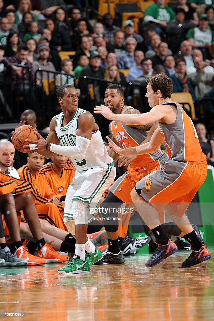 Rajon Rondo #9 of the Boston Celtics looks to make a pass against the Phoenix Suns on January 9, 2013 at the TD Garden in Boston, Massachusetts.