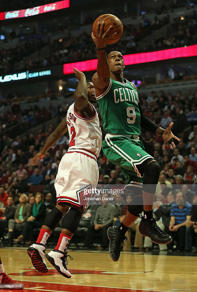 Rajon Rondo #9 of the Boston Celtics moves past Nate Robinson #2 of the Chicago Bulls for a shot at the United Center on November 12, 2012 in Chicago, Illinois.