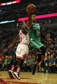 Rajon Rondo of the Boston Celtics moves past Nate Robinson of the Chicago Bulls for a shot at the United Center on November 12 2012 in Chicago...