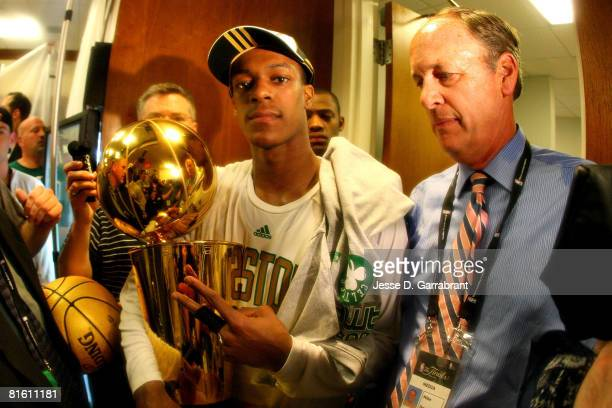Rajon Rondo of the Boston Celtics organization hold the Larry O'Brien championship trophy after defeating the Los Angeles Lakers 13192 in Game Six of...