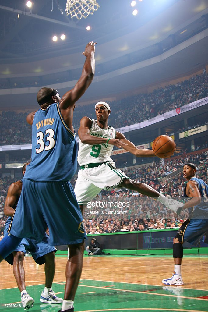 rajon-rondo-of-the-boston-celtics-passes-against-brendan-haywood-of-picture-id77659348