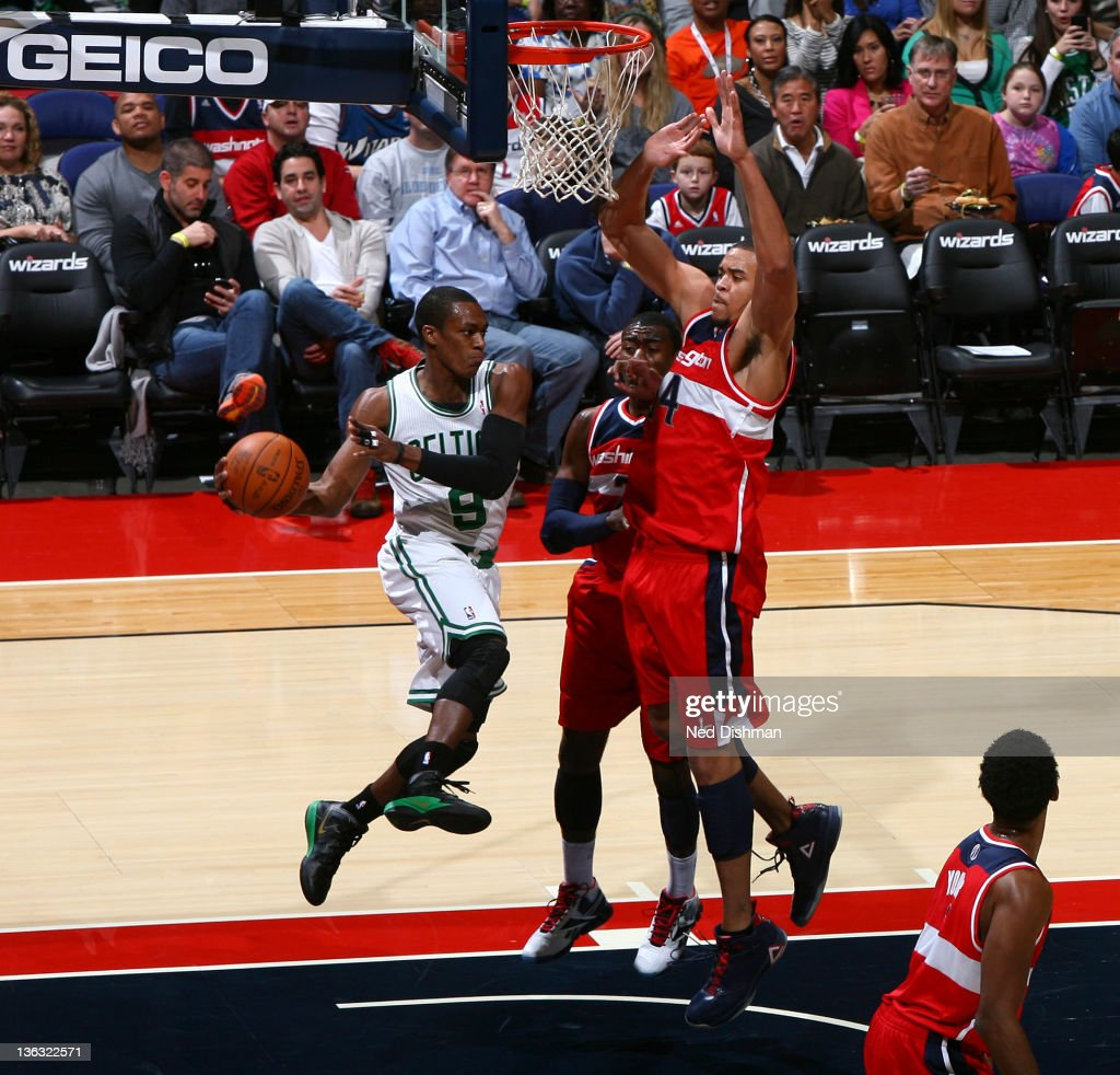 <a gi-track='captionPersonalityLinkClicked' href=/galleries/search?phrase=Rajon+Rondo&family=editorial&specificpeople=206983 ng-click='$event.stopPropagation()'>Rajon Rondo</a> #9 of the Boston Celtics passes against <a gi-track='captionPersonalityLinkClicked' href=/galleries/search?phrase=JaVale+McGee&family=editorial&specificpeople=4195625 ng-click='$event.stopPropagation()'>JaVale McGee</a> #34 and <a gi-track='captionPersonalityLinkClicked' href=/galleries/search?phrase=John+Wall&family=editorial&specificpeople=2265812 ng-click='$event.stopPropagation()'>John Wall</a> #2 of the Washington Wizards during the game at the Verizon Center on January 1, 2012 in Washington, DC.