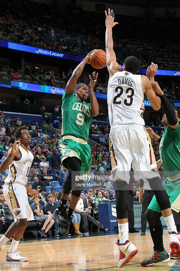 <a gi-track='captionPersonalityLinkClicked' href=/galleries/search?phrase=Rajon+Rondo&family=editorial&specificpeople=206983 ng-click='$event.stopPropagation()'>Rajon Rondo</a> #9 of the Boston Celtics passes the ball in mid-air against the New Orleans Pelicans during an NBA game on March 16, 2014 at the Smoothie King Center in New Orleans, Louisiana.