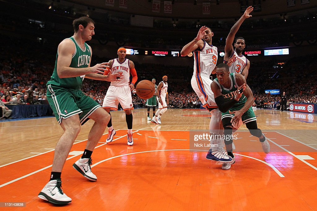 Rajon Rondo #9 of the Boston Celtics passes the ball to Nenad Krstic #4 against Jared Jeffries #9 and Shawne Williams #3 of the New York Knicks in Game Four of the Eastern Conference Quarterfinals during the 2011 NBA Playoffs on April 24, 2011 at Madison Square Garden in New York City.