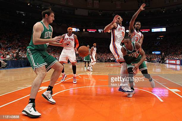 Rajon Rondo of the Boston Celtics passes the ball to Nenad Krstic against Jared Jeffries and Shawne Williams of the New York Knicks in Game Four of...