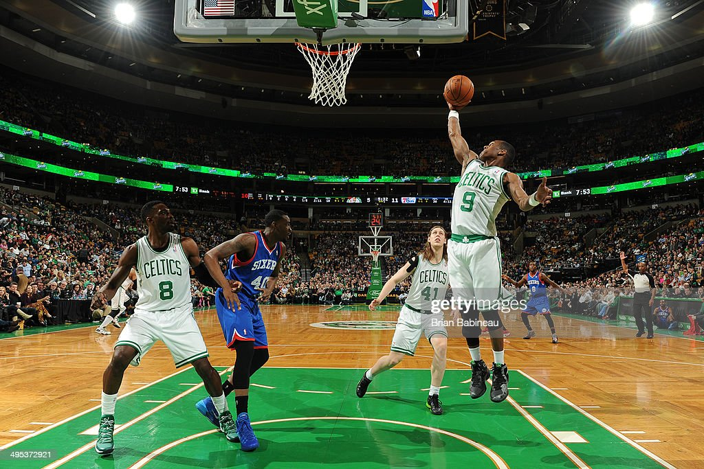 <a gi-track='captionPersonalityLinkClicked' href=/galleries/search?phrase=Rajon+Rondo&family=editorial&specificpeople=206983 ng-click='$event.stopPropagation()'>Rajon Rondo</a> #9 of the Boston Celtics rebounds the ball against the Philadelphia 76ers on April 4, 2014 at the TD Garden in Boston, Massachusetts.