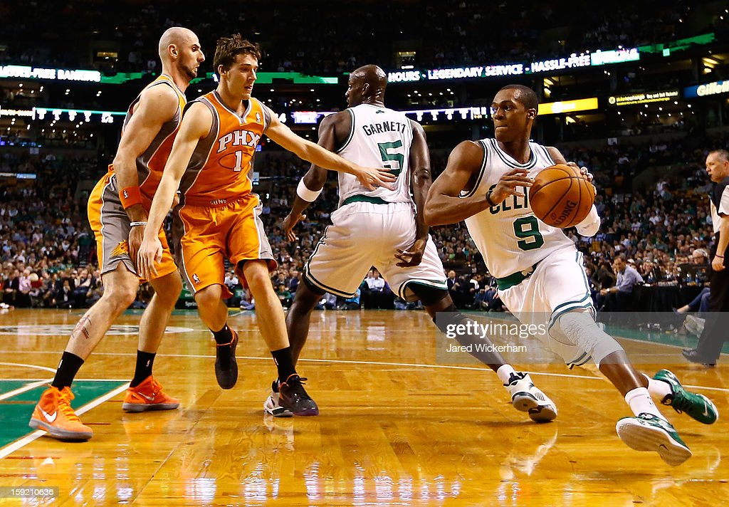 Rajon Rondo #9 of the Boston Celtics runs around his teammate Kevin Garnett #5 with the ball against the Phoenix Suns during the game on January 9, 2013 at TD Garden in Boston, Massachusetts.