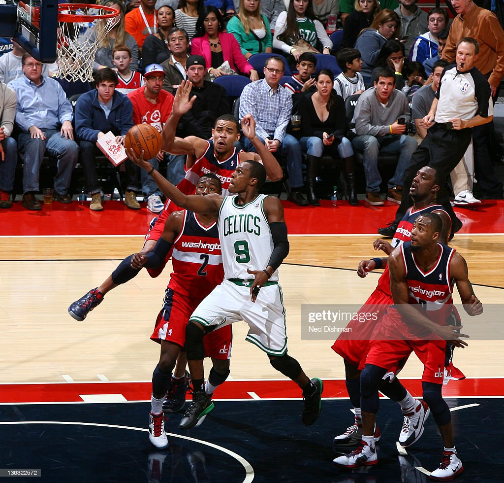 <a gi-track='captionPersonalityLinkClicked' href=/galleries/search?phrase=Rajon+Rondo&family=editorial&specificpeople=206983 ng-click='$event.stopPropagation()'>Rajon Rondo</a> #9 of the Boston Celtics shoots against <a gi-track='captionPersonalityLinkClicked' href=/galleries/search?phrase=JaVale+McGee&family=editorial&specificpeople=4195625 ng-click='$event.stopPropagation()'>JaVale McGee</a> #34 and <a gi-track='captionPersonalityLinkClicked' href=/galleries/search?phrase=John+Wall&family=editorial&specificpeople=2265812 ng-click='$event.stopPropagation()'>John Wall</a> #2 of the Washington Wizards during the game at the Verizon Center on January 1, 2012 in Washington, DC.
