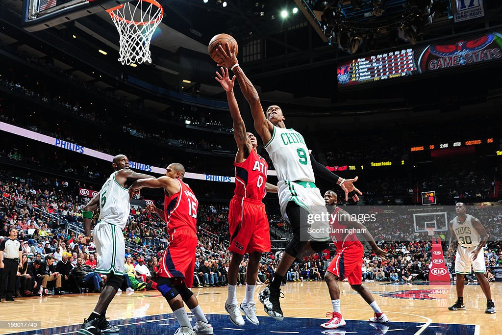 Rajon Rondo #9 of the Boston Celtics shoots against Jeff Teague #0 of the Atlanta Hawks on January 5, 2013 at Philips Arena in Atlanta, Georgia.