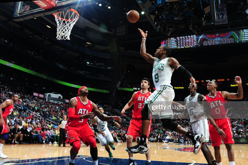 <a gi-track='captionPersonalityLinkClicked' href=/galleries/search?phrase=Rajon+Rondo&family=editorial&specificpeople=206983 ng-click='$event.stopPropagation()'>Rajon Rondo</a> #9 of the Boston Celtics shoots against <a gi-track='captionPersonalityLinkClicked' href=/galleries/search?phrase=Josh+Smith+-+Giocatore+di+basket+-+Classe+1985&family=editorial&specificpeople=201983 ng-click='$event.stopPropagation()'>Josh Smith</a> #5 and <a gi-track='captionPersonalityLinkClicked' href=/galleries/search?phrase=Zaza+Pachulia&family=editorial&specificpeople=202939 ng-click='$event.stopPropagation()'>Zaza Pachulia</a> #27 of the Atlanta Hawks on January 5, 2013 at Philips Arena in Atlanta, Georgia.