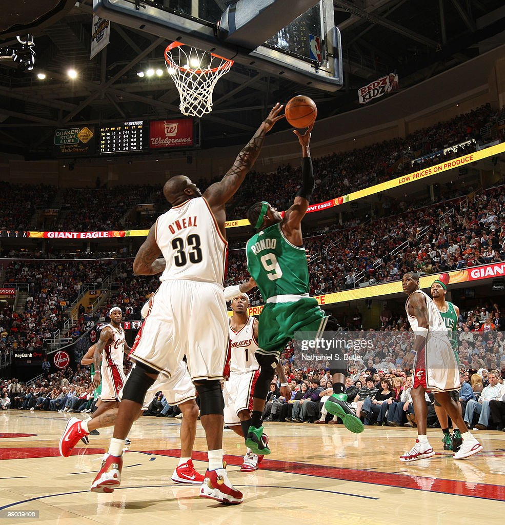 Rajon Rondo #9 of the Boston Celtics shoots against Shaquille O'Neal #33 of the Cleveland Cavaliers in Game Five of the Eastern Conference Semifinals during the 2010 NBA Playoffs on May 11, 2010 at the Quicken Loans Arena in Cleveland, Ohio.