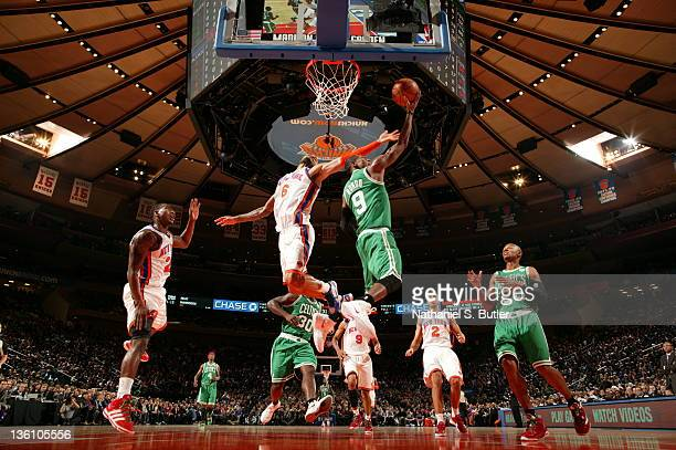 Rajon Rondo of the Boston Celtics shoots against Tyson Chandler of the New York Knicks during the game on December 25 2011 at Madison Square Garden...