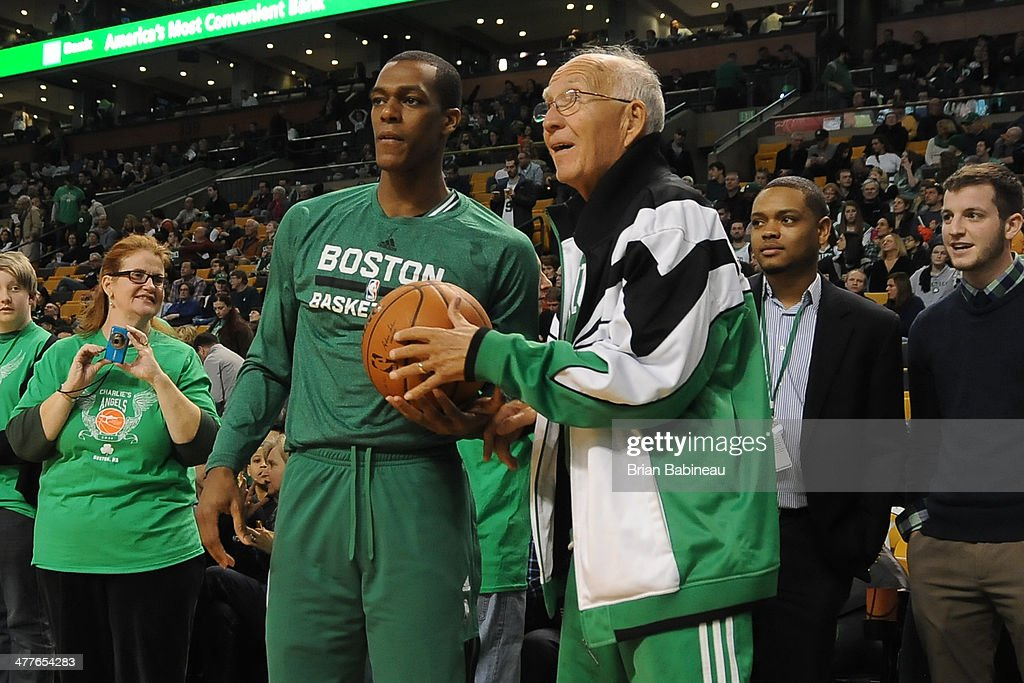 Rajon Rondo #9 of the Boston Celtics shoots around with a fan during warm ups before the game against the Detroit Pistons on March 9, 2014 at the TD Garden in Boston, Massachusetts.