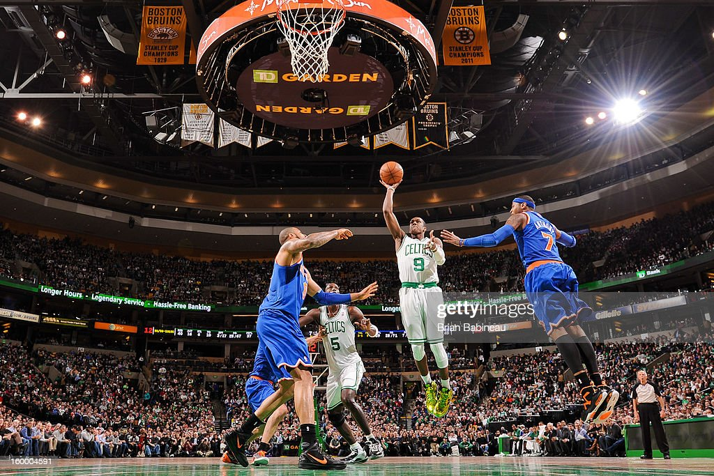 Rajon Rondo #9 of the Boston Celtics shoots in the lane against Tyson Chandler #6 and Carmelo Anthony #7 of the New York Knicks on January 24, 2013 at the TD Garden in Boston, Massachusetts.