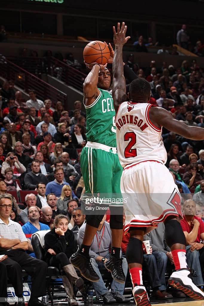Rajon Rondo #9 of the Boston Celtics shoots over Nate Robinson #2 of the Chicago Bulls on November 12, 2012 at the United Center in Chicago, Illinois.