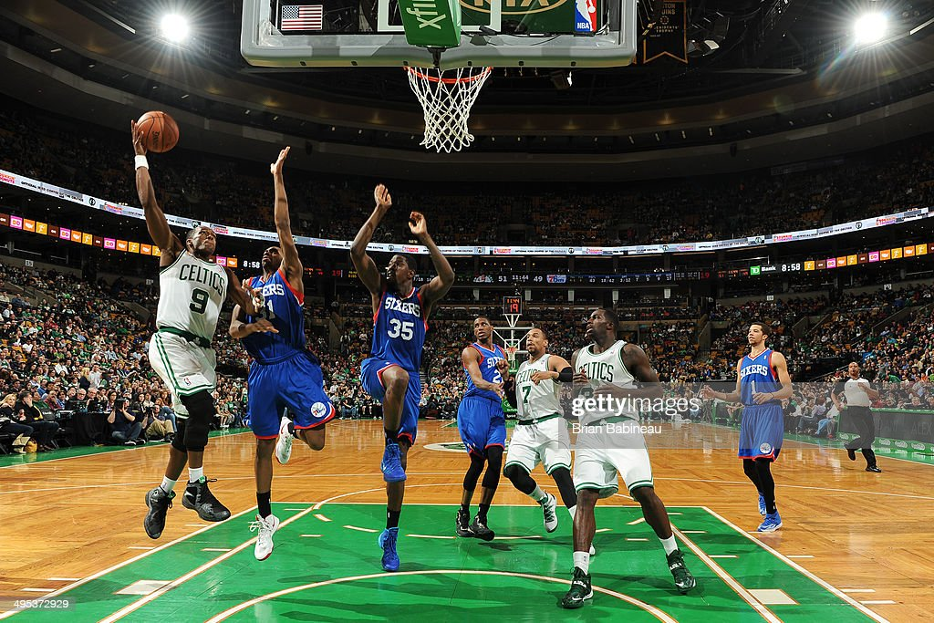 <a gi-track='captionPersonalityLinkClicked' href=/galleries/search?phrase=Rajon+Rondo&family=editorial&specificpeople=206983 ng-click='$event.stopPropagation()'>Rajon Rondo</a> #9 of the Boston Celtics shoots the ball against Hollis Thompson #31 and Henry Sims #35 of the Philadelphia 76ers on April 4, 2014 at the TD Garden in Boston, Massachusetts.