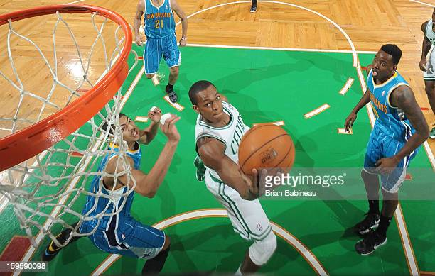 Rajon Rondo of the Boston Celtics shoots the ball against the New Orleans Hornets on January 16 2013 at the TD Garden in Boston Massachusetts NOTE TO...
