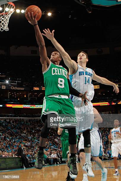 Rajon Rondo of the Boston Celtics shoots the ball over Jason Smith of the New Orleans Hornets at New Orleans Arena on December 28 2011 in New Orleans...