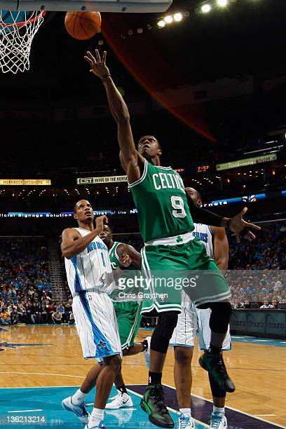 Rajon Rondo of the Boston Celtics shoots the ball over Trevor Ariza of the New Orleans Hornets at New Orleans Arena on December 28 2011 in New...