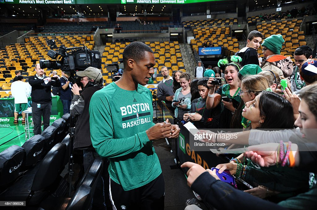 <a gi-track='captionPersonalityLinkClicked' href=/galleries/search?phrase=Rajon+Rondo&family=editorial&specificpeople=206983 ng-click='$event.stopPropagation()'>Rajon Rondo</a> #9 of the Boston Celtics signs autographs for fans before the game against the Utah Jazz on November 6, 2013 at the TD Garden in Boston, Massachusetts.