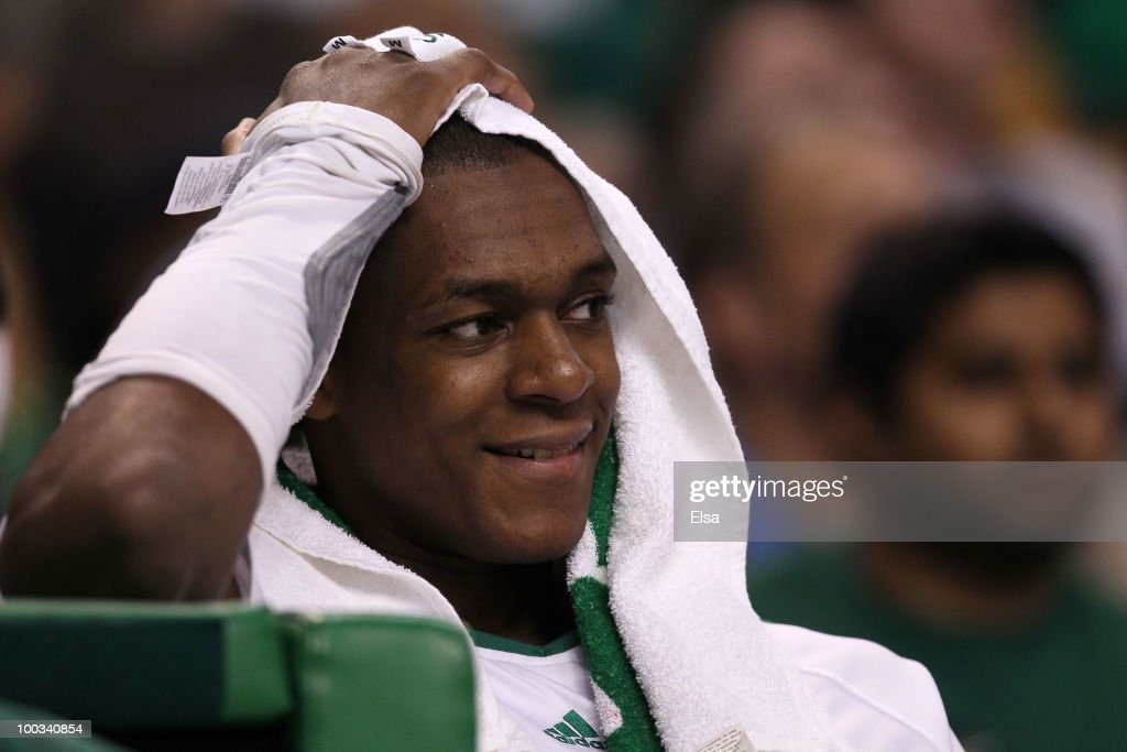 <a gi-track='captionPersonalityLinkClicked' href=/galleries/search?phrase=Rajon+Rondo&family=editorial&specificpeople=206983 ng-click='$event.stopPropagation()'>Rajon Rondo</a> #9 of the Boston Celtics smiles as he looks on from the bench late in the game against the Orlando Magic at TD Banknorth Garden in Game Three of the Eastern Conference Finals during the 2010 NBA Playoffs on May 22, 2010 in Boston, Massachusetts.