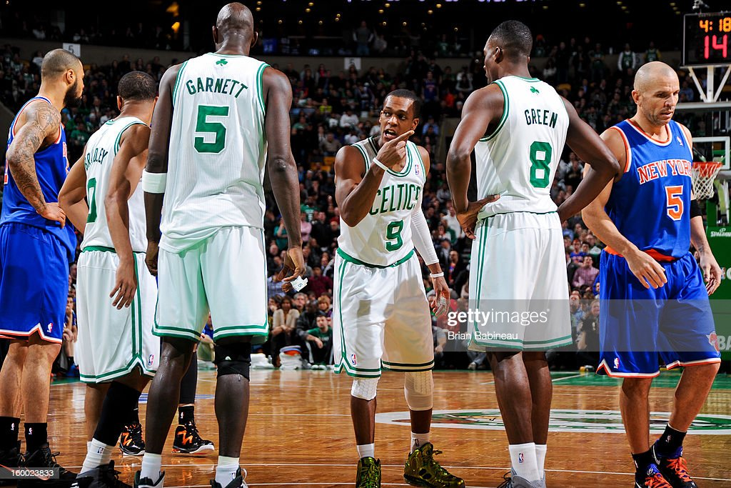 Rajon Rondo #9 of the Boston Celtics speaks to teammates Kevin Garnett #5 and Jeff Green #8 before resuming play against the New York Knicks on January 24, 2013 at the TD Garden in Boston, Massachusetts.