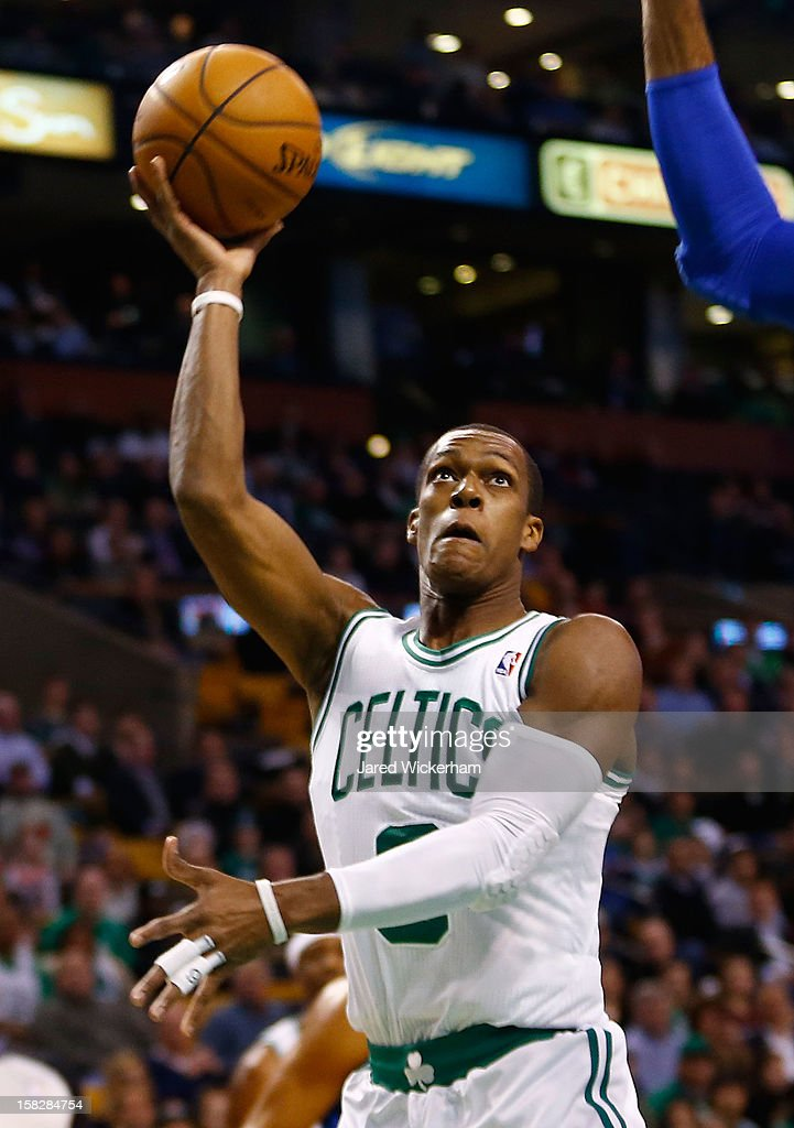 Rajon Rondo #9 of the Boston Celtics takes a shot against the Dallas Mavericks during the game on December 12, 2012 at TD Garden in Boston, Massachusetts.