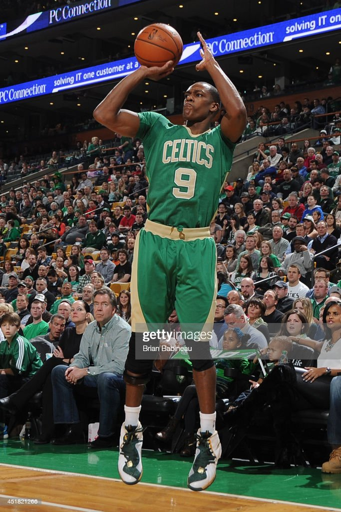 <a gi-track='captionPersonalityLinkClicked' href=/galleries/search?phrase=Rajon+Rondo&family=editorial&specificpeople=206983 ng-click='$event.stopPropagation()'>Rajon Rondo</a> #9 of the Boston Celtics takes a shot against the Phoenix Suns on March 14, 2014 at the TD Garden in Boston, Massachusetts.