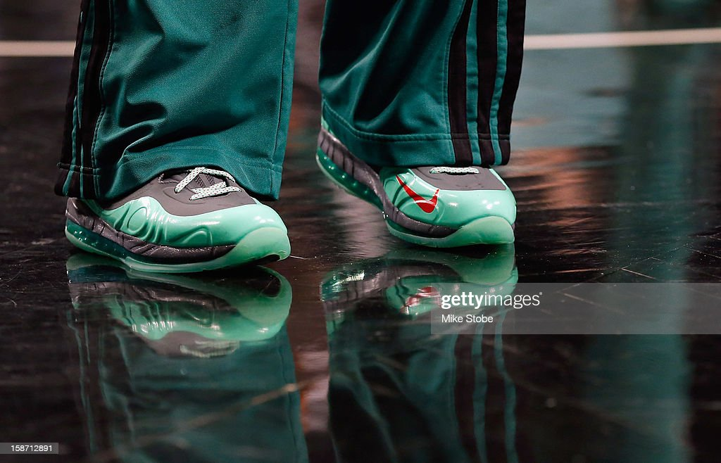 Rajon Rondo #9 of the Boston Celtics wears Nike sneakers during warm ups prior to the game against the Brooklyn Nets at the Barclays Center on December 25, 2012 in the Brooklyn borough of New York City.