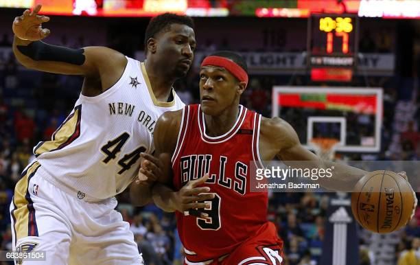 Rajon Rondo of the Chicago Bulls drives against Solomon Hill of the New Orleans Pelicans during the first half of a game at the Smoothie King Center...