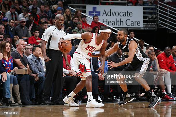 Rajon Rondo of the Chicago Bulls handles the ball against Tony Parker of the San Antonio Spurs during a game at the United Center on December 8 2016...