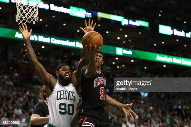 Rajon Rondo of the Chicago Bulls takes a shot against Amir Johnson of the Boston Celtics during the first quarter of Game One of the Eastern...