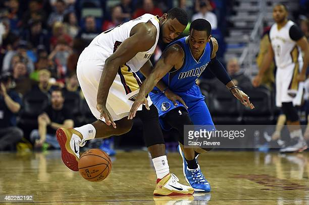 Rajon Rondo of the Dallas Mavericks attempts to steal the ball from Tyreke Evans of the New Orleans Pelicans during the second half of a game at the...