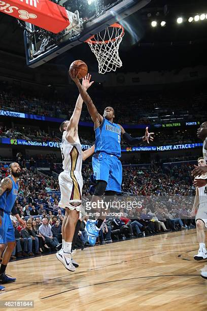 Rajon Rondo of the Dallas Mavericks goes up for a shot against the New Orleans Pelicans on January 25 2015 at Smoothie King Center in New Orleans...