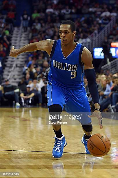 Rajon Rondo of the Dallas Mavericks handles the ball during the second half of a game against the New Orleans Pelicans at the Smoothie King Center on...