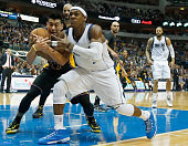 Rajon Rondo of the Dallas Mavericks scrambles for the ball against Jeremy Lin of the Los Angeles Lakers in the first half at American Airlines Center...
