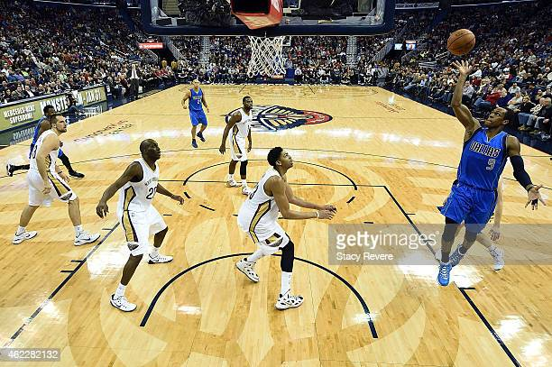 Rajon Rondo of the Dallas Mavericks takes a shot against the New Orleans Pelicans during the second half of a game at the Smoothie King Center on...
