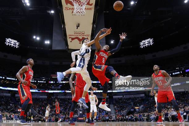 Rajon Rondo of the New Orleans Pelicans and Jamal Murray of the Denver Nuggets go for a rebound during the second half of a game at the Smoothie King...