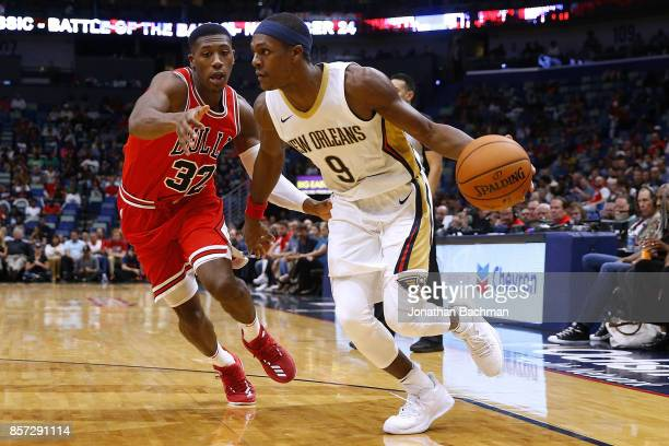 Rajon Rondo of the New Orleans Pelicans drives against Kris Dunn of the Chicago Bulls during the second half of a game at the Smoothie King Center on...