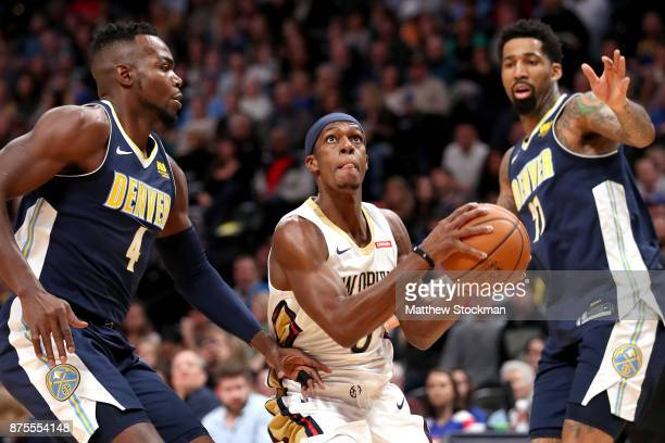 Rajon Rondo of the New Orleans Pelicans drives to the basket against Paul Millsap and Wilson Chandler of the Denver Nuggets at the Pepsi Center on...