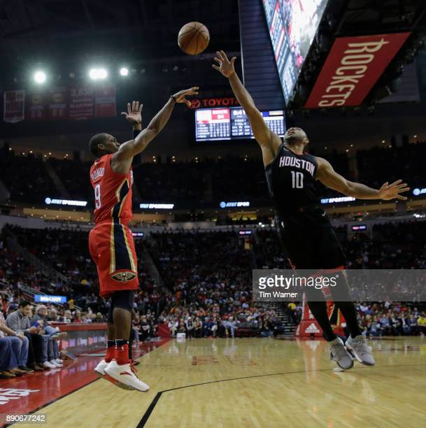 Rajon Rondo of the New Orleans Pelicans takes a three point shot defended by Eric Gordon of the Houston Rockets in the second half at Toyota Center...