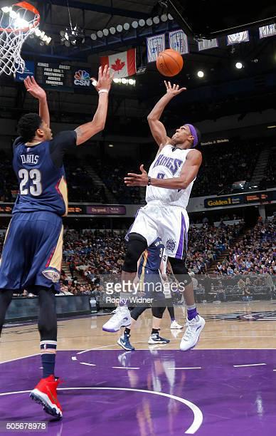 Rajon Rondo of the Sacramento Kings shoots against Anthony Davis of the New Orleans Pelicans on January 13 2016 at Sleep Train Arena in Sacramento...