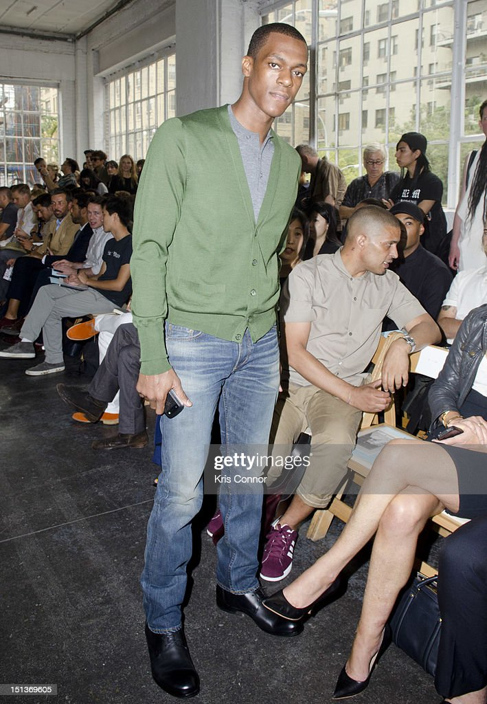<a gi-track='captionPersonalityLinkClicked' href=/galleries/search?phrase=Rajon+Rondo&family=editorial&specificpeople=206983 ng-click='$event.stopPropagation()'>Rajon Rondo</a> poses for a photo during the Duckie Brown Spring 2013 Mercedes-Benz Fashion Week Show at Industria Superstudio on September 6, 2012 in New York City.