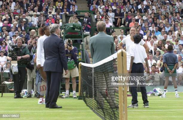 Raju Tital aged 12 from Calcutta tosses the coin as defending champion Lindsay Davenport and Venus Williams looks on before the start of the Women's...