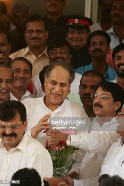 Rajya Sabha Elections Industrialist Rahul Bajaj coming out of Vidhan Bhavan after winning the Rajya Sabha seat Also seen Jitendra Avhad and Pandurang...