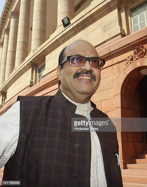 Rajya Sabha member Amar Singh arrives to attend the joint session of Parliament on the opening day of Budget session at Parliament House on March 12...