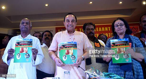 Rajya Sabha members Subramanian Swamy and former RSS ideal K N Govindacharya release a publication at a seminar on 'Emergency' organised by Virat...
